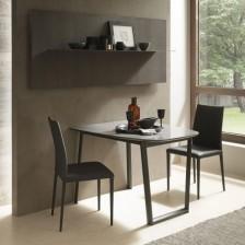 Tavolo a parete allungabile; piano ceramica Pietra Grey Lucida K07; struttura grafite goffrato M11
